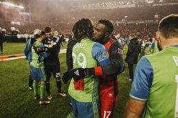 Roman Toress and Jozy Altidore hug it out.