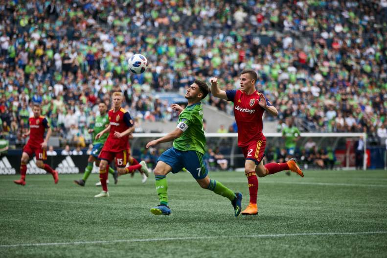 Cristian Roldan heads the ball versus RSL