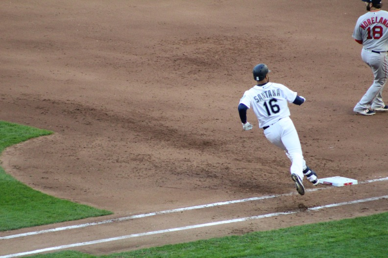 Domingo Santana rounds first base