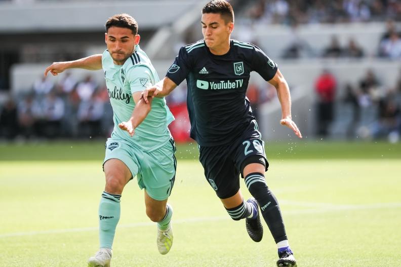 Cristian Roldan and Eduard Atuesta battle for the ball